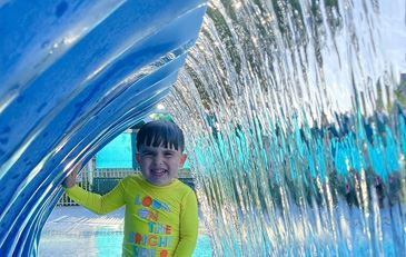 child in SplashPad