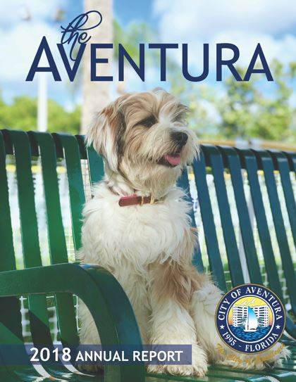 The Aventura 2018 Annual Report Cover. This image contains a picture of a dog.